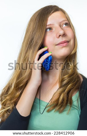 Blonde teenage girl phoning with mobile phone - stock photo