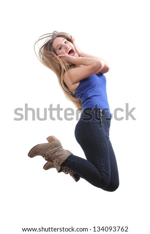 Blonde teenager jumping happy isolated on a white background - stock photo