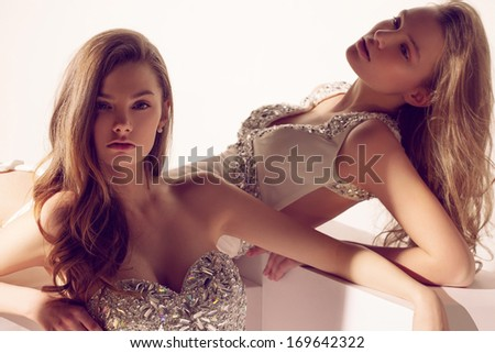 Blonde twins in white dresses morning - stock photo