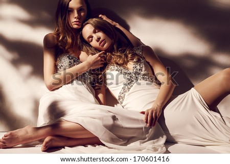 Blonde twins in white dresses morning