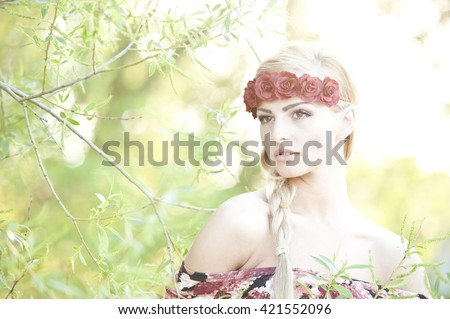 Blonde Wearing A Flower Crown - stock photo