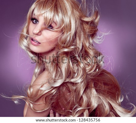 Blonde with beautiful curly hair - stock photo