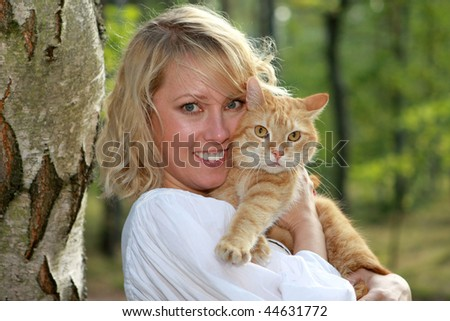Blonde with ginger cat - stock photo