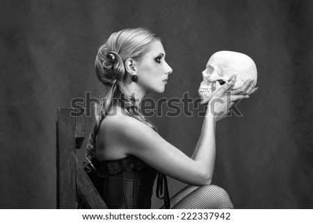 Blonde with skull, black and white version - stock photo