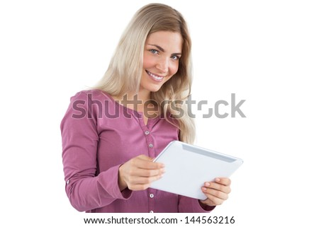 Blonde woman holding tablet pc on a white background