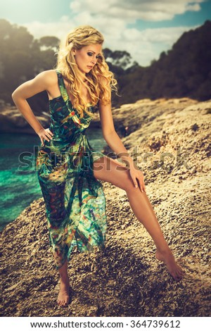 Blonde woman in a summer dress - stock photo