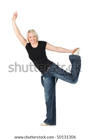 blonde woman in jeans and a dark shirt, smiling performs acrobatic etude. Isolated on the white
