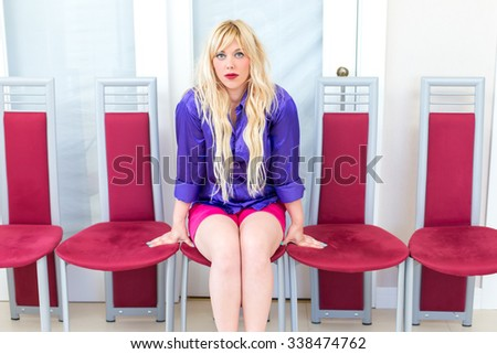 Blonde woman in the apartment - stock photo
