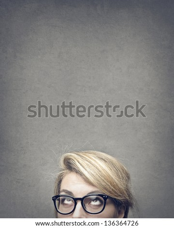 blonde woman looks up - stock photo