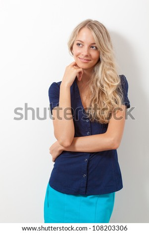 blonde woman over white wall - stock photo
