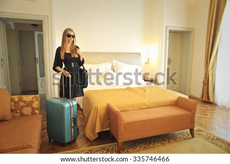 Blonde woman ready to leave her hotel room