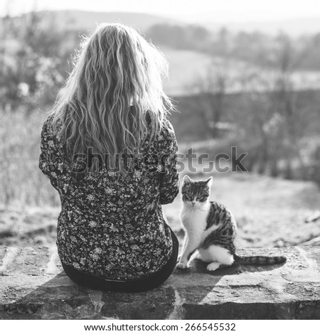 Blonde woman resting with her adorable cat - stock photo