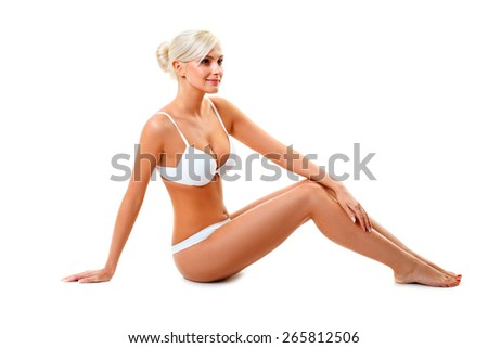 blonde woman wearing white underwear sitting on the floor