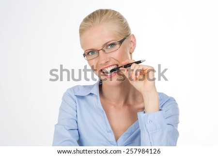 blonde woman with a pen in her mouth