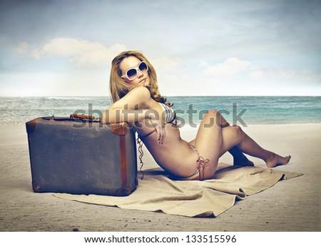 blonde woman with bikini on the beach - stock photo