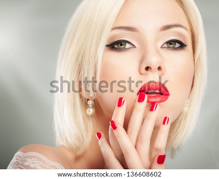 Blonde woman with bright red lips and manicure - stock photo