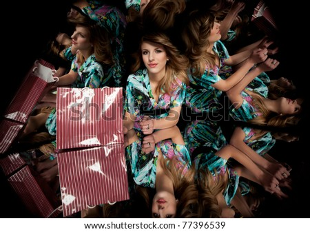 blonde woman with shopping bag kaleidoscope mirrors - stock photo