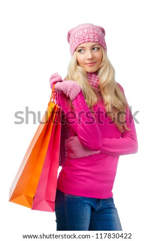 blonde woman with shopping bags looking  to the side over white - stock photo
