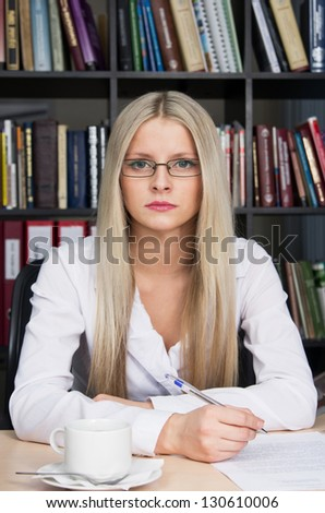 Blonde young girl at office - stock photo
