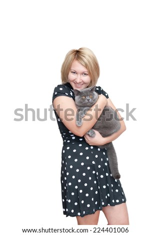 Blonde young woman is holding a male british shorthair cat. - stock photo