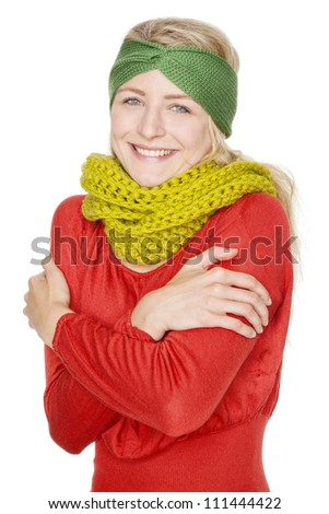 blonde young woman with warm wool scarf - stock photo