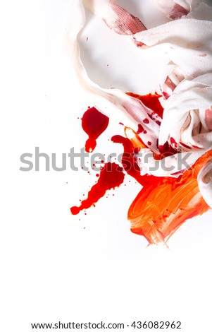 Blood and bandages on a white background. - stock photo