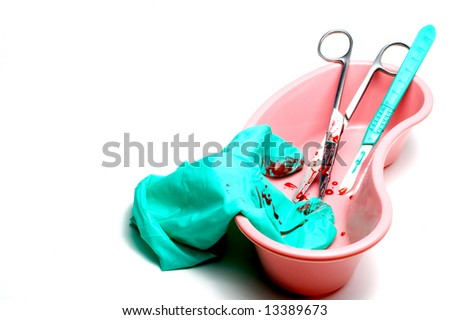 Blood Covered Surgery Tools - stock photo