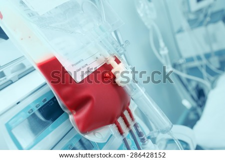 Blood for transfusion on a background of intensive care units equipment - stock photo