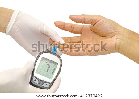 blood glucose meter, the blood sugar value is measured on a finger by  female doctor in white medical gloves isolated on white background.Saved with clipping path. - stock photo