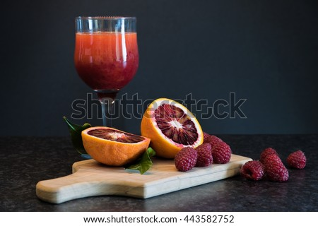 Blood orange, berries and a glass of freshly squeezed juice