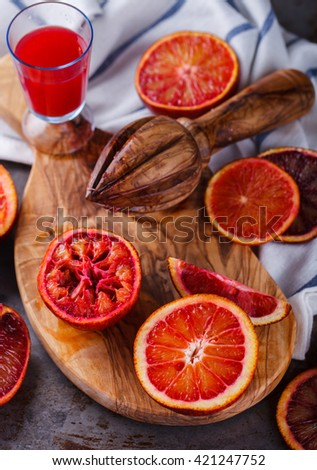 blood orange,freshly squeezed orange juice,on a wooden Board.selective focus. - stock photo