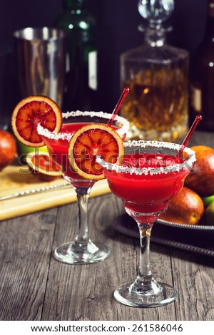 Blood Orange Margaritas with Salt: made with Tequila, juice from fresh Blood Oranges and Limes, Triple Sec, and a splash of Agave Syrup. - stock photo
