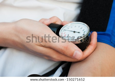 blood pressure gage in hands - stock photo