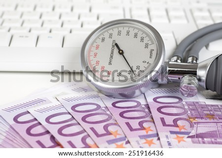 Blood pressure gauge on 500 Euro notes - stock photo