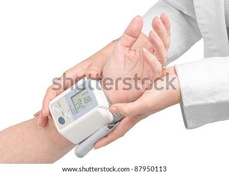 Blood pressure measurement with a digital monitor. - stock photo