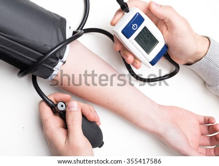 Blood pressure measuring - stock photo