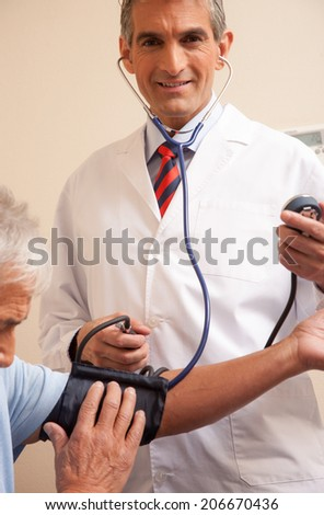 Blood pressure measuring. Doctor and patient. Health care - stock photo