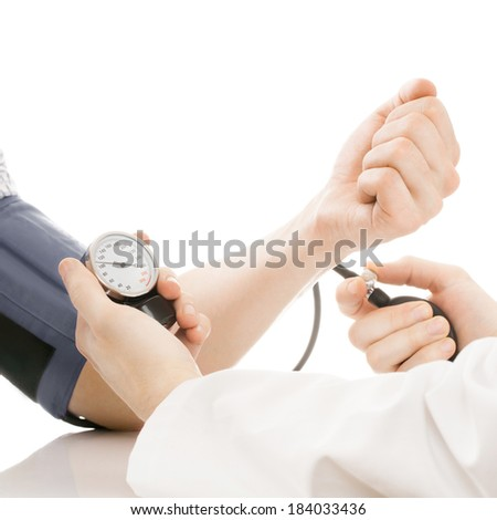 Blood pressure measuring. Doctor measuring patients blood pressure - studio shoot isolated on white - 1 to 1 ratio - stock photo