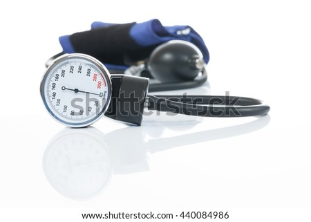 Blood pressure measuring medical equipment on white - a tonometer