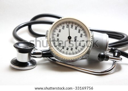 blood pressure meter and stethoscope isolated - stock photo