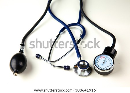 Blood pressure meter and stethoscope, isolated on white - stock photo