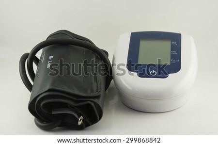 Blood pressure monitor on white background - stock photo
