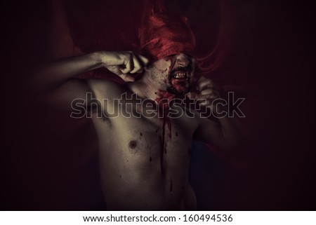 Blood, Scary, Male vampire with huge red coat and blood - stock photo