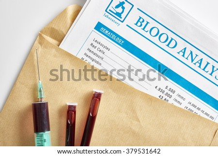 Blood test report in envelope with vials and syringe with blood sampling over white glass table. Horizontal composition. Top view. - stock photo