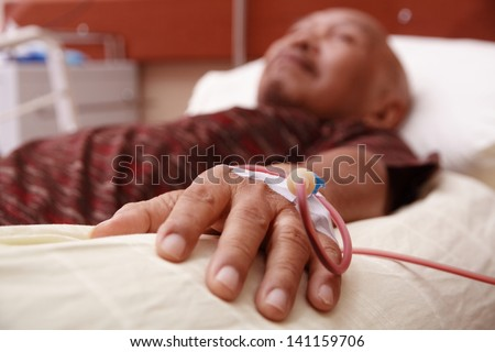 blood transfusion on a hand of an old man - stock photo