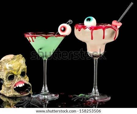 Bloody Halloween cocktail in martini and margarita glass - stock photo