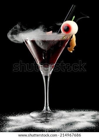 Bloody Halloween cocktail with smoke - stock photo