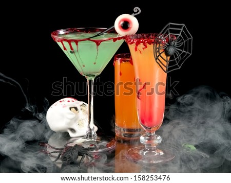 Bloody Halloween cocktails in smoke - stock photo
