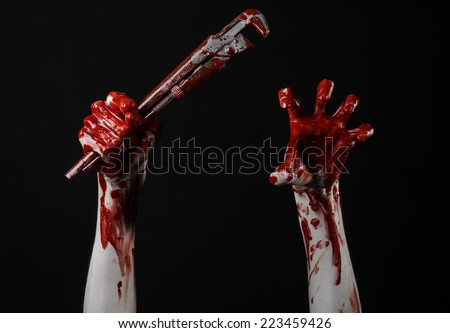 bloody hand holding an adjustable wrench, bloody key, crazy plumber, bloody theme, halloween theme, black background,isolated, bloody hand of an assassin, bloody murderer, psycho, bloody monkey wrench - stock photo