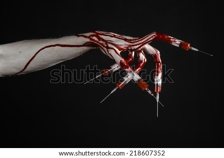 Bloody hand with syringe on the fingers, toes syringes, hand syringes, horrible bloody hand, halloween theme, zombie doctor, black background, isolated - stock photo